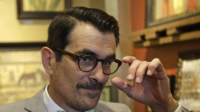 Modern Family actor Ty Burrell looks on during an interview Thursday, June 19, 2014, in Salt Lake City. Burrell is headlining a fundraiser in Salt Lake City on Thursday, an event staged by an organization that helps pay for the legal costs of challenging same-sex marriage bans. (AP Photo/Rick Bowmer)