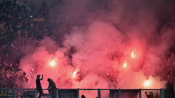 Supporters of Maribor light fireworks during the Champions League group G soccer match between FC Schalke 04 and Maribor in Gelsenkirchen, Germany, Tuesday, Sept. 30, 2014. (AP Photo/Martin Meissner)
