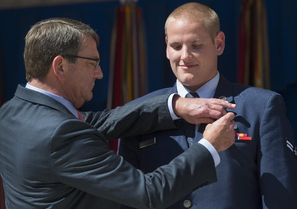 Train attack hero in 'good spirits' after stabbing