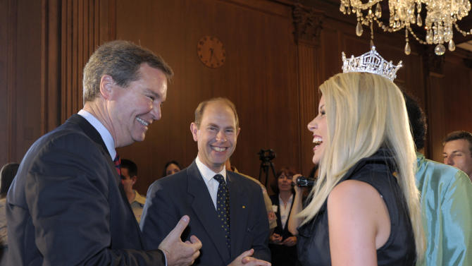 Prince Edward, center, shares a laugh with Sam Haskell, left, and Miss America 2011 Teresa Scanlan, right, during a reception on Capitol Hill in Washington, Monday, June 20, 2011. (AP Photo/Susan Walsh)
