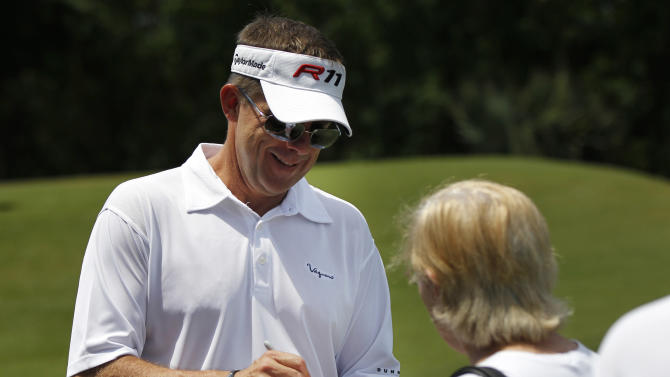 New Orleans Saints NFL football head coach Sean Payton, left, signs autographs during the Pro-Am rounds of the PGA golf Zurich Classic at TPC Louisiana in Avondale, La., Wednesday, April 25, 2012. (AP Photo/Gerald Herbert)