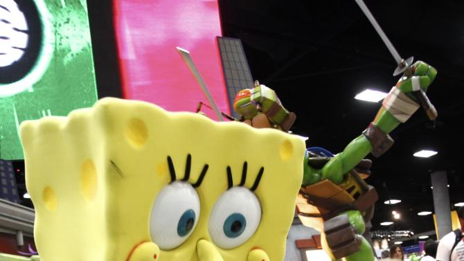 COMMERCIAL IMAGE - A fan is seen with SpongeBob SquarePants during Comic-Con on Sunday, July 15, 2012, in San Diego, Calif. (Photo by Joe Kohen/Invision for Nickelodeon/AP Images)