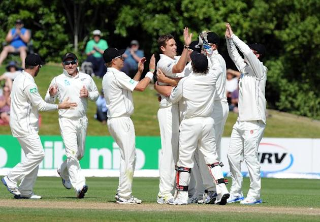 New Zealand's Tim Southee, centre, celebrates with team mates after dismissing West Indies Marlon Samuels for 23 on the fourth day of the International cricket match, University Oval, Dunedin, New