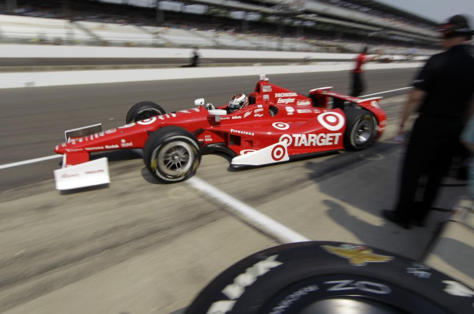 IndyCar driver Scott Dixon, of New Zealand, pulls out of the pit area on the final day of practice for the Indianapolis 500 auto race at the Indianapolis Motor Speedway in Indianapolis, Friday, May 25, 2012. The 96th running of the race is Sunday. (AP Photo/Darron Cummings)