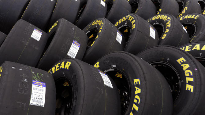 FILE - In this Friday, Oct. 11, 2013, file photo, Goodyear tires sit in the garage area during practice for the NASCAR Sprint Cup series auto race at Charlotte Motor Speedway in Concord, N.C. Goodyear reports quarterly results before the market open on Tuesday, Oct. 29, 2013. (AP Photo/Mike McCarn)