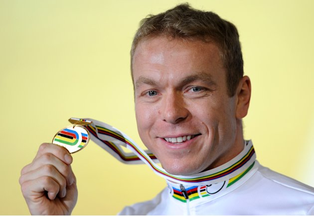 Chris Hoy of Britain poses with his gold medal after winning the men&amp;#39;s keirin at the 2012 Track Cycling World Championships in Melbourne, on April 8, 2012.  IMAGE STRICTLY RESTRICTED TO EDITORIAL 