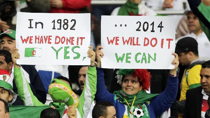 Algeria supporters hold signs reminding on the 1982 World Cup when Algeria didn't make it to the second round during the World Cup round of 16 soccer match between Germany and Algeria at the Estadio Beira-Rio in Porto Alegre, Brazil, Monday, June 30, 2014