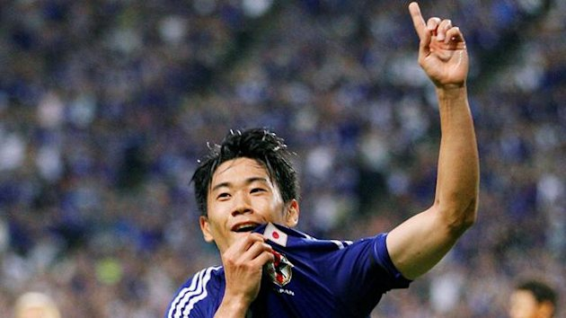 Japan's Shinji Kagawa celebrates his goal against South Korea during their international friendly soccer match in Sapporo, northern Japan August 10, 2011