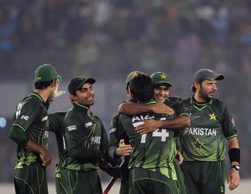 Pakistan's cricketers celebrate after winning the match
