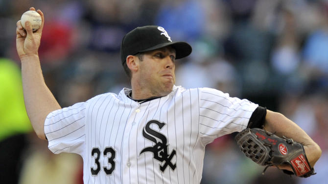 Chicago White Sox starter Dylan Axelrod delivers a pitch during the first inning of a baseball against the Boston Red Sox in Chicago, Monday, May 20, 2013. (AP Photo/Paul Beaty)