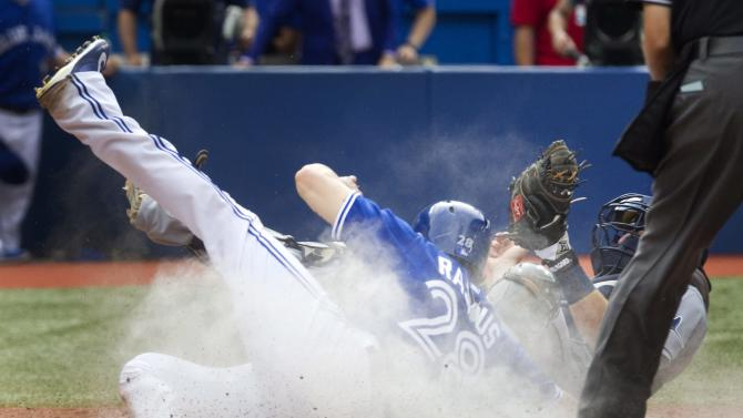 Reyes lifts Blue Jays over Rays 5-4 in 10 innings