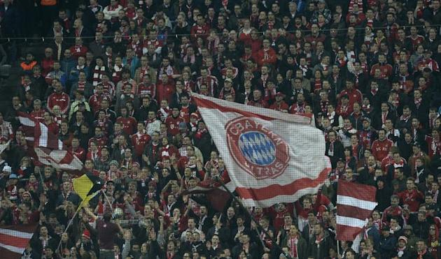 Bayern Munich's fans reacts during the UEFA Champions League last 16 second leg football match between Bayern Munich and FC Arsenal in Munich, southern Germany, on March 11, 2014