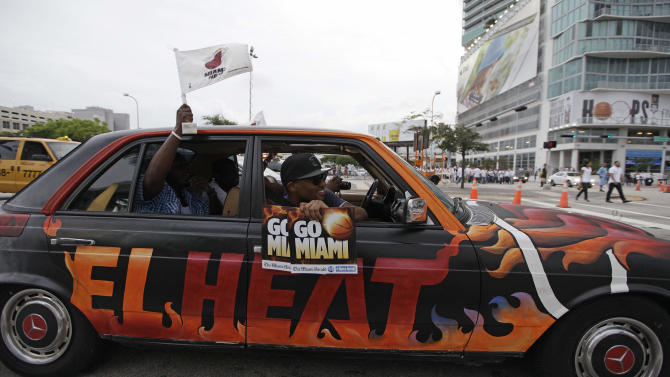 Miami Heat fans pass in front of American Airlines Arena before Game 5 of the NBA finals basketball series against the Oklahoma City Thunder, Thursday, June 21, 2012, in Miami. (AP Photo/Lynne Sladky)