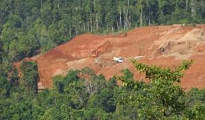 A truck picks up earth containing nickel ore from a mine cut out of forests on Halmahera island in eastern Indonesia
