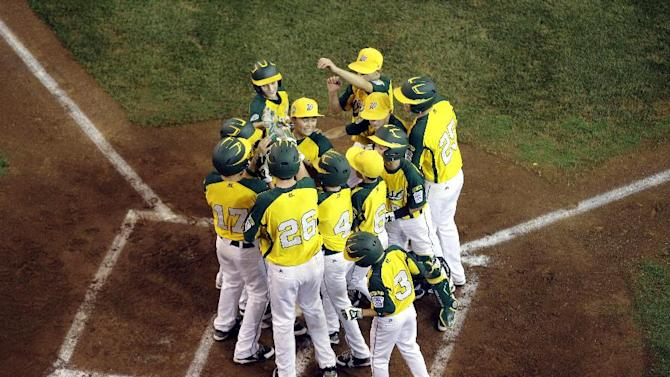 Petaluma, Calif., players celebrate after a grand slam by Hance Smith in the first inning of a baseball game against San Antonio, Texas, at the Little League World Series, Thursday, Aug. 23, 2012, in South Williamsport, Pa. California won 11-1. (AP Photo/Matt Slocum)