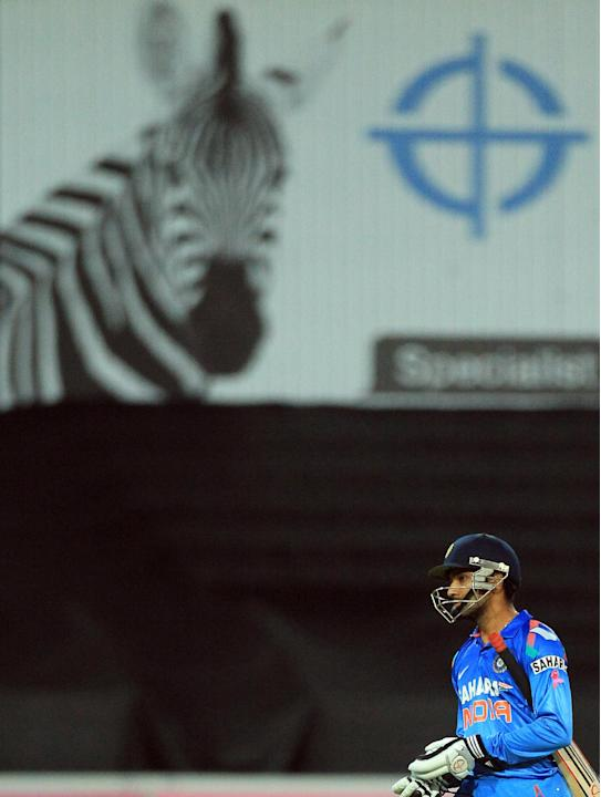 India's batsman Rohit Sharma, leaves the field after being run out by South Africa's David Miller, during their 1st One Day International cricket match at Wanderers stadium in Johannesburg, So