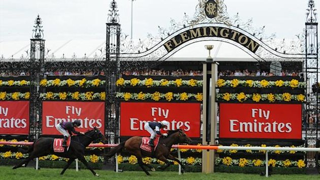 Irish stayer Green Moon ridden by jockey Brett Pebble leads Fiorente ridden by James McDonald over the line in the 152nd Melbourne Cup at the Flemington Racecourse (AFP)
