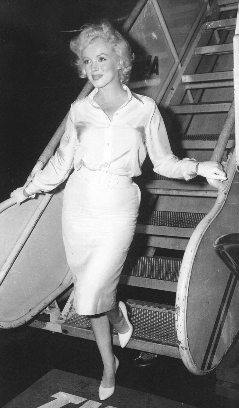 "FILE - In this July 7, 1958 file photo, actress Marilyn Monroe leaves New York by air for Hollywood, to start work on ""Some Like It Hot,"" her first film in two years. (AP Photo, File)"