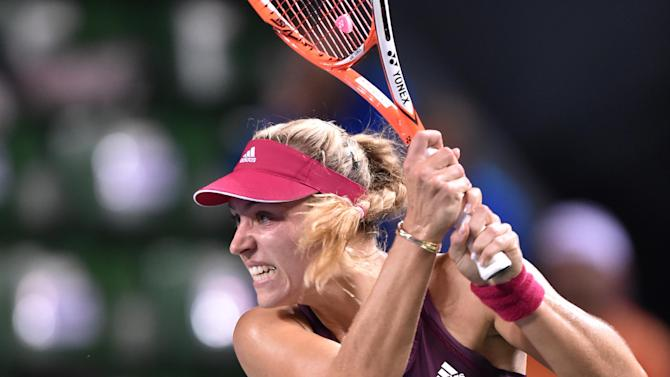 Angelique Kerber of Germany follows her shot against Elina Svitolina of Ukraine during the Pan Pacific Open tennis tournament in Tokyo on September 17, 2014