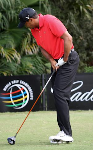 Tiger Woods grimaces after he hit off the 12th tee during the final round of the Cadillac Championship golf tournament on Sunday, March 11, 2012 in Doral, Fla. Woods withdrew from the tournament, and was driven away in a cart. (AP Photo/Wilfredo Lee)