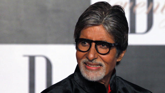 """Bollywood star Amitabh Bachchan arrives for a party on the eve of his 70th birthday in Mumbai, India, Wednesday, Oct. 10, 2012. Affectionately known as """"Big B,"""" Bachchan has acted in around 180 films in a career spanning four decades in Bollywood, the home of India's prolific movie industry. (AP Photo/ Rajanish Kakade)"""