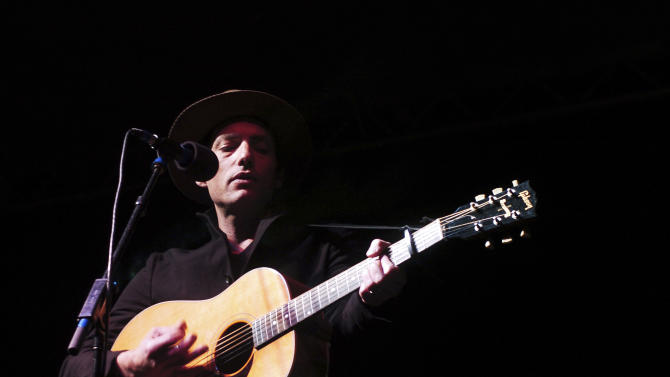 Jakob Dylan, of The Wallflowers, performs at a Denver rally organized by opponents of hydraulic fracturing Tuesday, Oct. 23, 2012. The rally was meant to push for the acceleration of clean-energy alternatives and to educate the public on what co-organizer Allison Wolff  calls the dangers of hydraulic fracturing, which involves blasting water, sand and chemicals underground to free oil and natural gas. (AP Photo/Thomas Peipert)