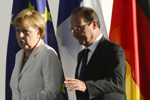 <p>This file photo shows German Chancellor Angela Merkel and French President Francois Hollande, in Berlin, on August 23. The leaders of France and Germany meet on Saturday to mark a seminal 1962 speech by Charles de Gaulle, with the euro crisis and a proposed EADS-BAE merger also on the agenda.</p>