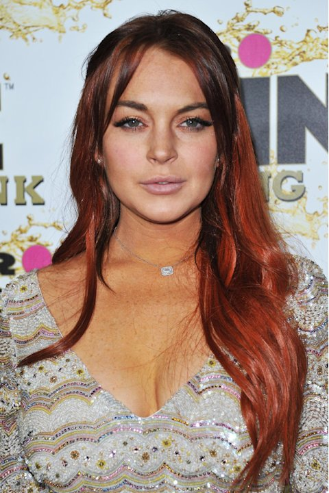 FILE - In this Oct. 11, 2012 file photo, Lindsay Lohan attends the Mr. Pink Ginseng launch party at the Beverly Wilshire hotel in Beverly Hills, Calif. Lohan is due to be arraigned on Wednesday, Dec.