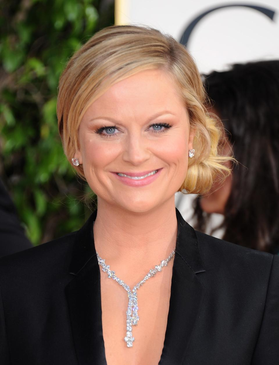 Host Amy Poehler arrives at the 70th Annual Golden Globe Awards at the Beverly Hilton Hotel on Sunday Jan. 13, 2013, in Beverly Hills, Calif. (Photo by Jordan Strauss/Invision/AP)
