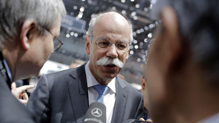 Chairman of Daimler AG Dieter Zetsche, of Germany, answers media questions after the presentation of the new A 45 AMG car during the first media day of the 83rd Geneva International Motor Show, Switzerland, Tuesday, March 5, 2013. The Motor Show will open its gates to the public from March 7 to 17.  (AP Photo/Laurent Cipriani)