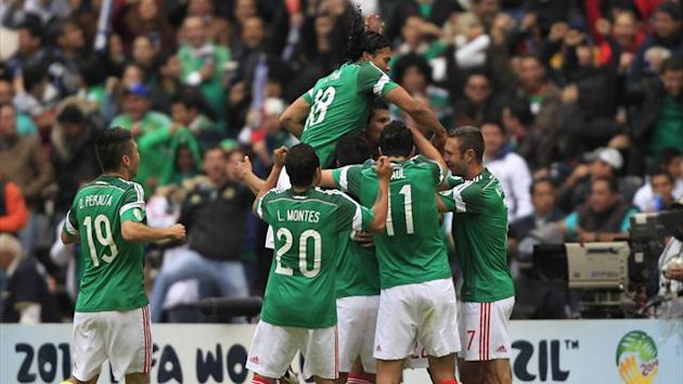 Mexico players celebrate against New Zealand (Reuters)