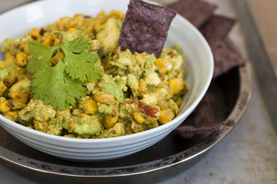 In this image taken on January 7, 2013, chipotle corn guacamole is shown served in a bowl in Concord, N.H. (AP Photo/Matthew Mead)