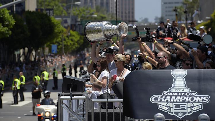Los Angeles Kings goalie Jonathan Quick holds up the Stanley Cup ...
