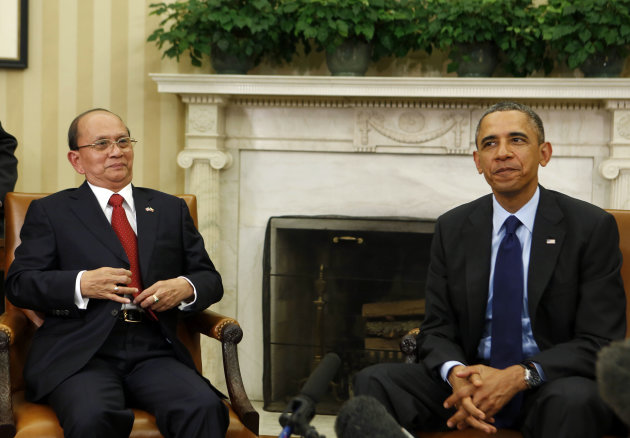 U.S. President Obama sits next to Myanmar's President Sein in the Oval Office at the White House in Washington