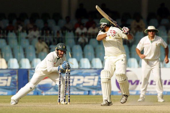 LAHORE, PAKISTAN - OCTOBER 12: Inzaman-ul-Haq is stumped by Mark Boucher during day five of the second test match series between Pakistan and South Africa held at the Gaddafi Stadium on October 12, 20