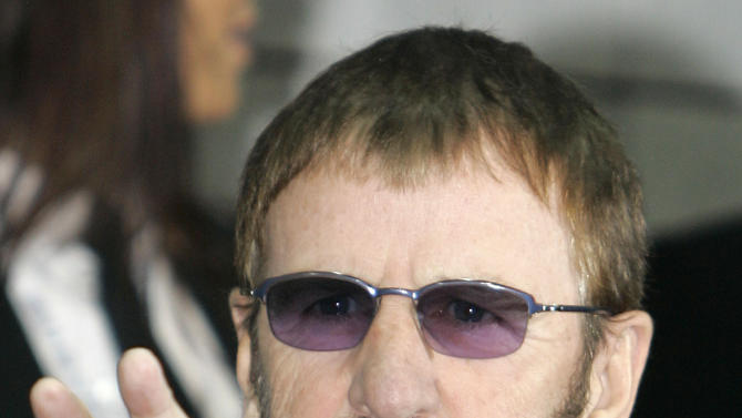 FILE - In this Nov.9, 2008 file photo, British singer Ringo Starr arrives at the 2008 World Music Awards ceremony in Monaco. In 2005, the Beatles' Ringo Starr took up residency in Monaco, where he gets to keep a higher percentage of royalties than he would in Britain or Los Angeles. France's tiny neighbor Monaco, with zero percent income tax for most people, has obvious appeal for the 72-year-old drummer and his estimated $240 million fortune.(AP Photo/Lionel Cironneau, File)