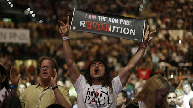 Vreth Liberty Zatikyan from Santa Monica, Calif., shows his support for Rep. Ron Paul, R-Texas, during a rally at the University of South Florida Sun Dome on the sidelines of the Republican National Convention in Tampa, Fla., on Sunday, Aug. 26, 2012. (AP Photo/Charles Dharapak)