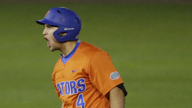 Florida Mike Rivera celebrates after hitting a double during the fifth inning of a Southeastern Conference NCAA college baseball tournament championship game at the Hoover Met, Sunday, May 24, 2015, in Hoover, Ala. Florida won 7-3. (AP Photo/Brynn Anderson)