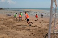 "Competitors during a game of sandbar soccer at the ""Outback Games"" in Darwin, Australia's Northern Territory. Sandbar soccer is football played on an uneven patch of beach"