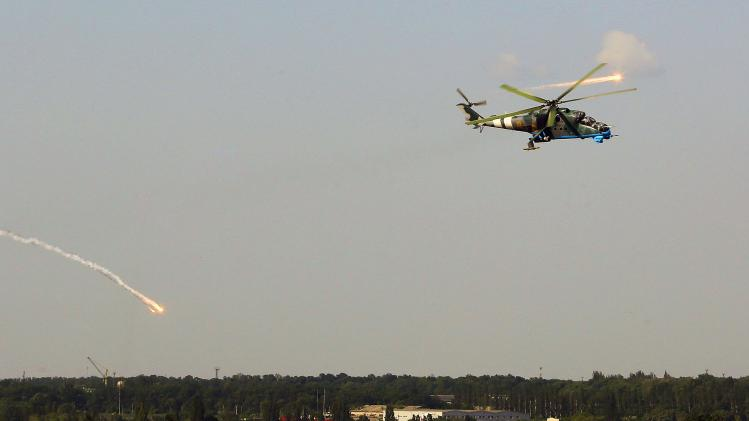 A Ukrainian helicopter gunship fires decoy flares after attacking Donetsk international airport