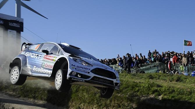 M-Sport World Rally Team driver Ott Tanak and his co-driver Raigo Molder, both from Estonia, steer their Ford Fiesta RS WRC during the Portugal FIA World Rally Championship Sunday, May 24, 2015 in Lameirinha, Fafe, Portugal. (AP Photo/Paulo Duarte)