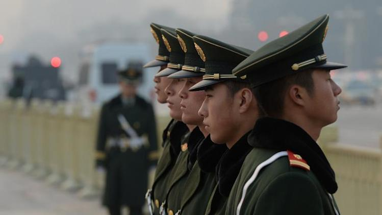 Chinese paramilitary police stand guard in Tiananmen Square as security is increased on the eve of an important Communist Party Congress in Beijing on November 8, 2013