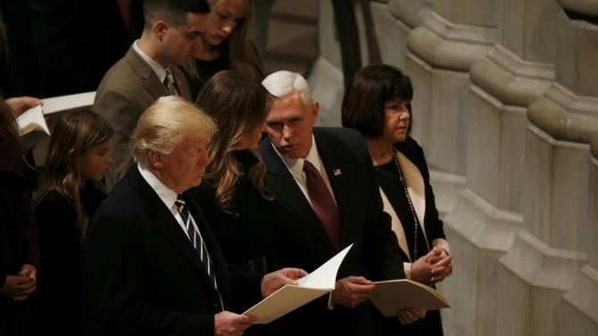 U.S. President Trump is accompanied by his wife Melania, Vice President Pence and his wife Karen during a prayer service at Washington National Cathedral the morning after his inauguration in Washington