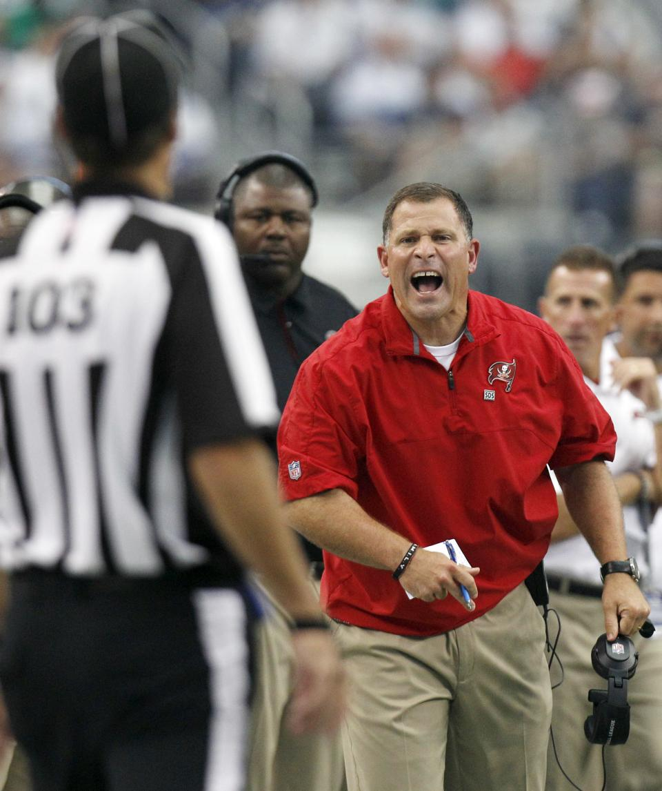 Tampa Bay Buccaneers head coach Greg Schiano, right, challenges the call on field to line judge Larry Skarpa (103) during the second half of an NFL football game against the Dallas Cowboys, Sunday, Sept. 23, 2012, in Arlington, Texas. (AP Photo/LM Otero)
