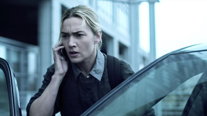 """In this image released by Warner Bros. Pictures, Kate Winslet is shown in a scene from the film """"Contagion."""" (AP Photo/Warner Bros. Pictures)"""