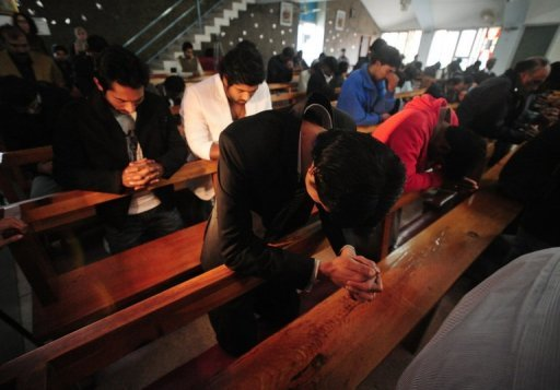<p>Pakistani Christians pray at the Fatima Church in Islamabad. Pakistan's president on Monday called on officials to explain the arrest on blasphemy charges of a Christian girl with Down's Syndrome who allegedly burnt pages inscribed with verses from the Koran.</p>
