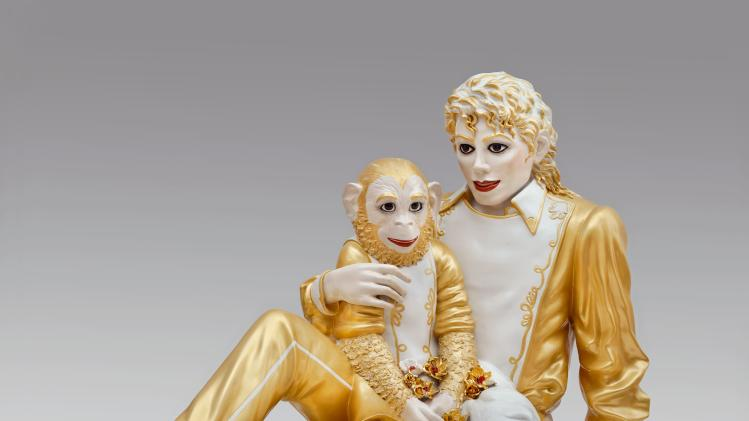 "This photo provided by the Metropolitan Museum of Art shows Jeff Koons' porcelain ""Michael Jackson and Bubbles,"" in the museum's new exhibition ""Regarding Warhol: Sixty Artists, Fifty Years.""  The exhibition begins Tuesday, Sept. 18, 2012, and runs through Dec. 31. (AP Photo/Metropolitan Museum of Art)"