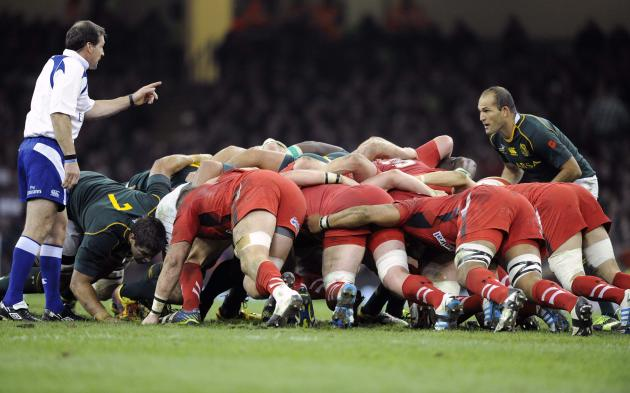 Referee Alain Rolland warns South Africa's Fourie du Preez as he takes a scrum against Wales during the international rugby union match at the Millennium Stadium in Cardiff,
