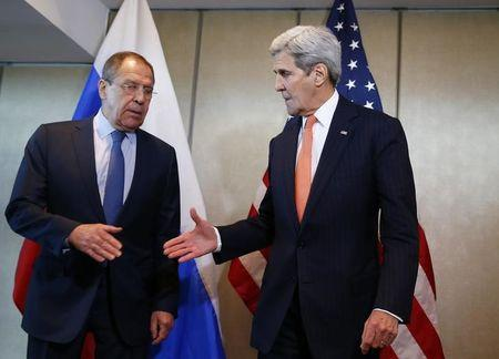 U.S. Foreign Secretary Kerry and Russian Foreign Minister Lavrov go for a handshake before their bilateral talks in Munich