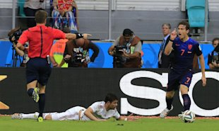 Netherlands' Daryl Janmaat (R) reacts after fouling Spain's Diego Costa to give up a penalty kick. (AP)